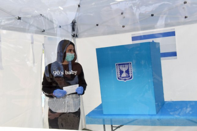 An Israeli casts her ballot during a demonstration by the Emergency Medical Service, and the Central Elections Committee, for voters quarantined at home because of the coronavirus. Photo by Debbie Hill/UPI