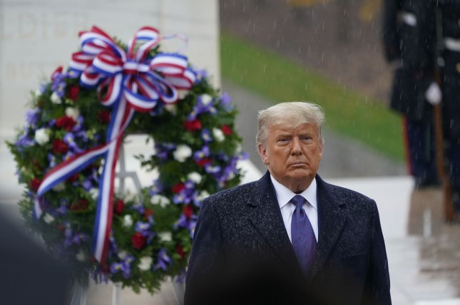 President Donald Trump prepares to depart as he and first lady Melania Trump attend the National Veterans Day Observance on Wednesday at Arlington National Cemetery in Arlington, Va. Photo by Chris Kleponis/UPI/Pool