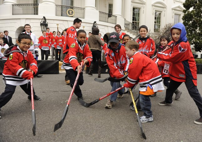 Children play a street hockey game on the South Lawn of the White House as part of First Lady Michelle Obama's Let's Move program in Washington on March 11, 2011. UPI/Roger L. Wollenberg.