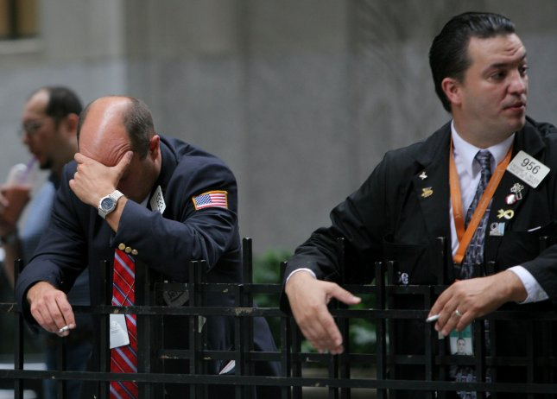 Traders take a cigarette break outside of the New York Stock Exchange. (File/UPI Photo/Monika Graff)