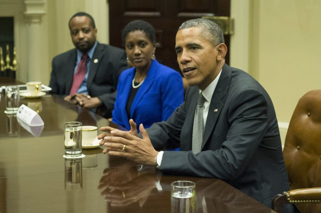 President Barack Obama meets with small business leaders, including Hester Clark (center), owner of the PR firm the Hester Group, and Marc Parham, Director of the Atlanta Urban League's Entrepreneurship Program, in the Roosevelt Room at the White House on October 11, 2013. UPI/Kevin Dietsch