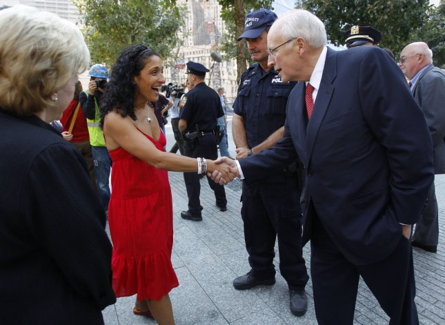Former U.S. Vice President Richard Cheney shakes hands with Anthoula Katsimatides, who in the attacks lost her brother John Katsimatides, an employee of Cantor-Fitzgerald, as Cheney visits during the first day that the 911 Memorial was opened to the public at the World Trade Center site in New York, September 12, 2011. UPI/Mike Segar/Pool
