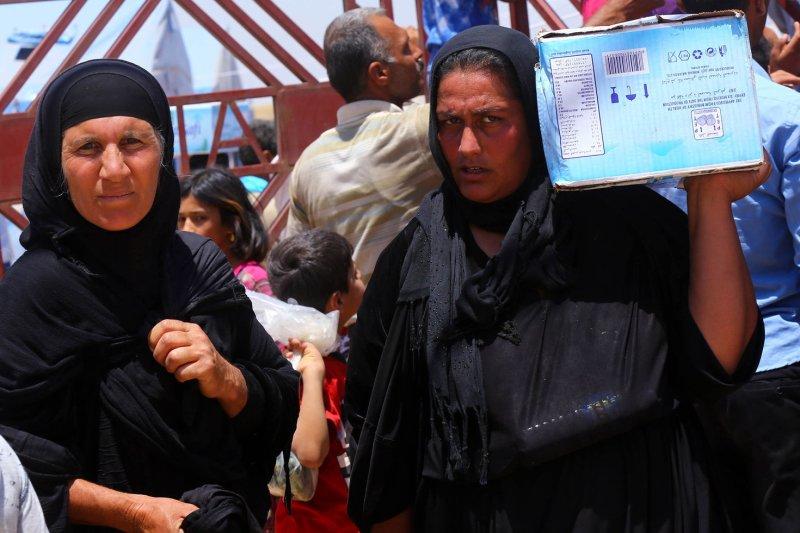 Christians in Iraq flee Islamic State advances