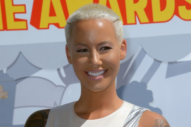 Amber Rose went nearly nude for the cover of 'How to Be a Bad Bitch.' File photo by Jim Ruymen/UPI