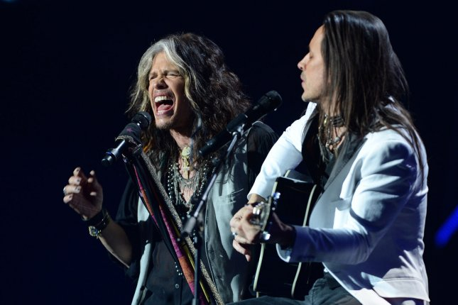Steven Tyler and guitarist Nuno Bettencourt perform at the Nobel Peace Prize Concert Oslo, Norway, in 2014. The Aerosmith frontman has sent presidential hopeful Donald Trump a cease-and-desist letter to stop using the band's song 'Dream On' during his campaign. File Photo by Rune Hellestad/UPI