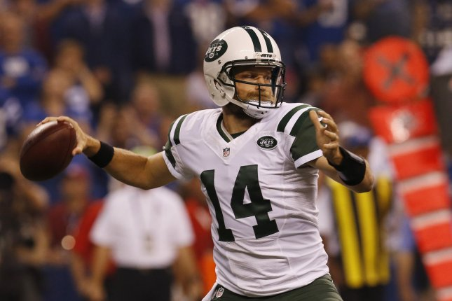 New York Jets quarterback Ryan Fitzpatrick (14) throws under pressure from the Indianapolis Colts' defense during the first half of play at Lucas Oil Stadium in Indianapolis, Indiana, September 21, 2015. Photo by John Sommers II/UPI