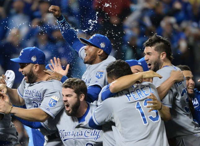 Members of the Kansas City Royals celebrate as they win the World Series defeating the New York Mets 7-2 in game 5 at Citi Field in New York City on November 2, 2015. The Royals are defending the title for the first time in 30 years. Photo by Pat Benic/UPI