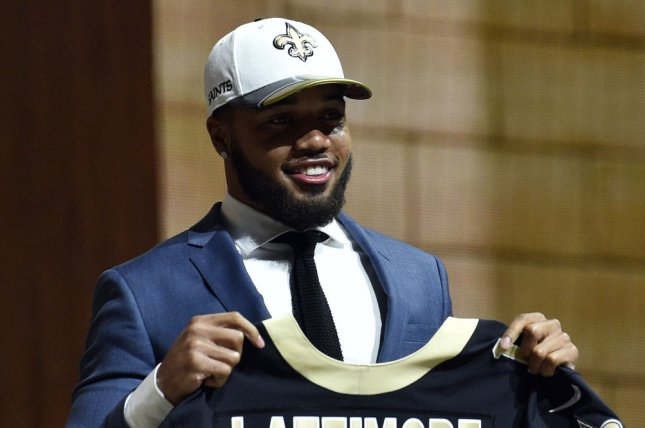 Marshon Lattimore poses for photographs after being selected by the New Orleans Saints as the 11th overall pick in the 2017 NFL Draft at the NFL Draft Theater in Philadelphia, PA on April 27, 2017. The 82nd NFL Draft returned to Philadelphia for the first time in more than 50 years and runs from April 27-29. Photo by Derik Hamilton/UPI