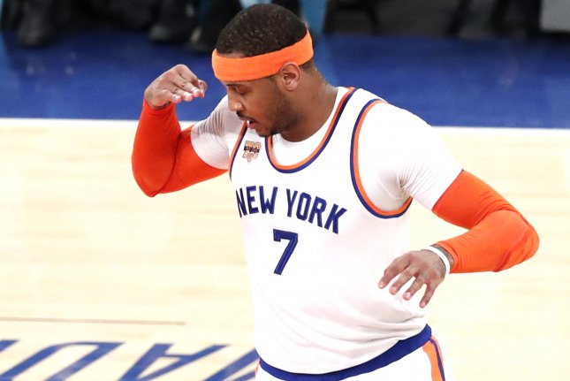 New York Knicks star Carmelo Anthony reacts after hitting a 3-point shot in the first half against the Charlotte Hornets on January 27 at Madison Square Garden in New York City. File photo by John Angelillo/UPI