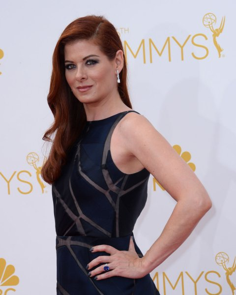 Debra Messing arrives at the Primetime Emmy Awards in Los Angeles on August 25, 2014. The actress will be seen in fresh episodes of her beloved sitcom Will & Grace, starting next month. File Photo by Jim Ruymen/UPI