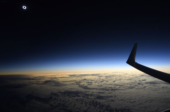 A total solar eclipse is viewed aboard a special flight from Schiphol Airport in Amsterdam, The Netherlands, in 2015. United, Southwest and Alaska Airlines are planning special flights during Monday's historic total eclipse. File Photo by Joe Marino/UPI