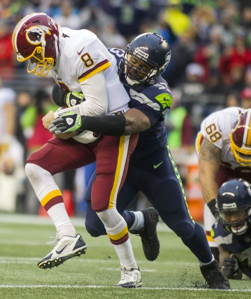 Former Seattle Seahawks defensive end Dwight Freeney sacks Washington Redskins quarterback Kirk Cousins during a game earlier this month. Photo by Jim Bryant/UPI