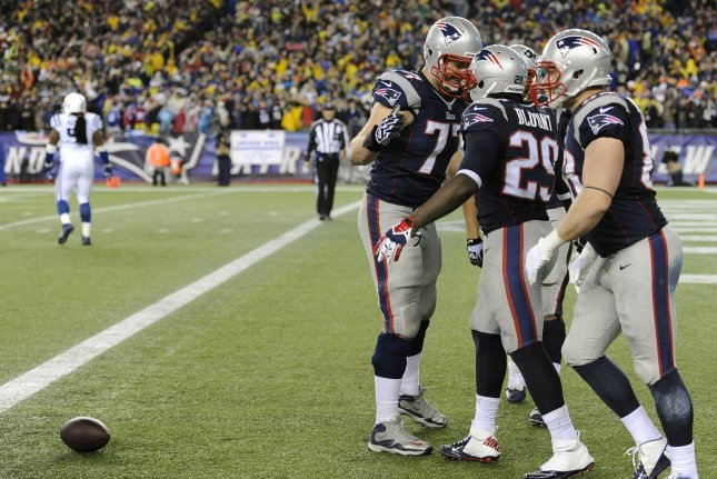 Former New England Patriots running back LeGarrette Blount (29) is congratulated by ex-Patriots tackle Nate Solder (77) after Blount scored on a 73-yard touchdown in the fourth quarter against the Indianapolis Colts in the AFC Divisional Round playoff game on January 11, 2014 at Gillette Stadium in Foxborough, Massachusetts. File photo by Matthew Healey/UPI