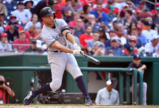 Giancarlo Stanton and the New York Yankees face the Texas Rangers on Sunday. Photo by Kevin Dietsch/UPI