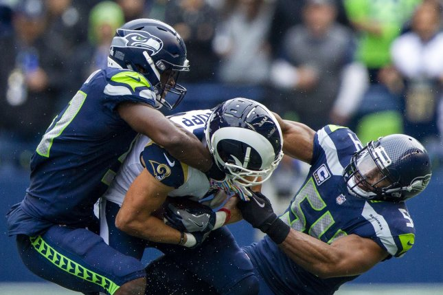 Los Angeles Rams receiver Cooper Kupp tries to break a tackle during a game against the Seattle Seahawks on October 7, 2018. Photo by Jim Bryant/UPI