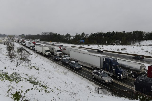 Motorists on I-70 westbound are snarled in traffic as the first winter storm of the season descends on the Mid-Atlantic in Fredrick, Md., on Thursday. Photo by David Tulis/UPI