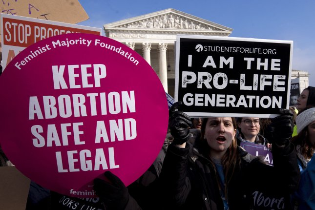 Protesters on both sides of the abortion issue demonstrate outside the U.S. Supreme Court building in Washington, D.C., on January 19. File Photo by Kevin Dietsch/UPI
