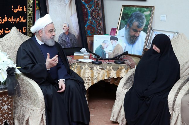 Iranian President Hassan Rouhani visits the family of the Iranian Gen. Qassem Soleimani at his home in Tehran on Saturday. Soleimani, head of the elite Quds Force, was killed by a U.S. airstrike in Baghdad. Photo courtesy of Iranian President's Office/UPI