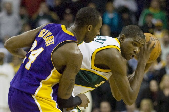 Current NBA star Kevin Durant (R) is guarded by Los Angeles Lakers legend Kobe Bryant during overtime in a game on Jan. 14, 2008, in Seattle. Durant scored 19 points in the matchup, while Bryant scored 48 points for the Lakers. File Photo by Jim Bryant/UPI