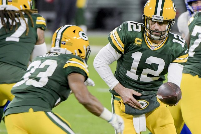 Green Bay Packers running back Aaron Jones (33) caught three touchdown passes from quarterback Aaron Rodgers (12) in a win over the Detroit Lions on Monday in Green Bay, Wis. File Photo by Mark Black/UPI