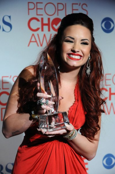 U.S. musician and 'X Factor' judge Demi Lovato, shown in a photo from January, described fellow judges Britney Spears as sweet and humble and Simon Cowell as annoying and old. UPI/Jim Ruymen