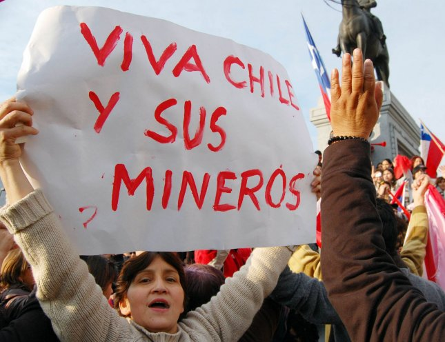 Chileans celebrate the news that 33 miners trapped for 17 days are alive in Plaza Italia, Santiago, Chile, on August 22, 2010. It may take months to rescue the men in a mine near the city of Copiapo, Atacama desert, 800 km (480 miles) north of Santiago. UPI/Jorge Matta
