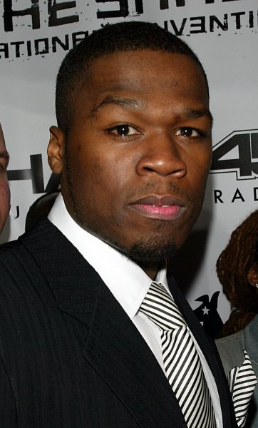 50 Cent poses for pictures at the party for Eminem's new Shade 45 Radio Channel on Sirius Satellite Radio at Roseland BallroomV in New York on October 28, 2004. (UPI Photo/Laura Cavanaugh)