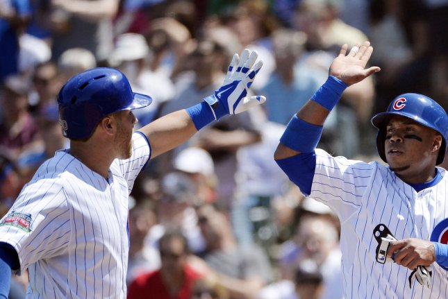 Chicago Cubs' Luis Valbuena (R) high-fives teammate Mike Olt after Olt hit a sacrifice fly scoring Valbuena during the fourth inning against the New York Yankees at Wrigley Field on May 21, 2014 in Chicago. UPI/Brian Kersey