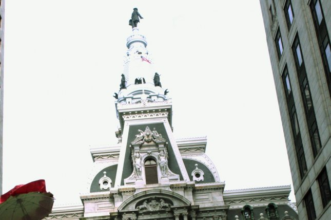The statue of William Penn atop Philadelphia City Hall looms over the city. UPI/John Anderson