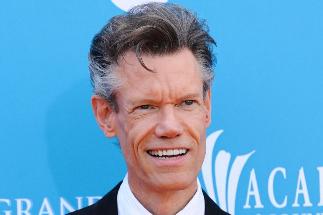 Randy Travis arrives on the Orange Carpet at the Academy of Country Music (ACM) Awards on April 18, 2010. While still recovering from a stroke, Travis spoke at the Country Music Hall of Fame class of 2016. File Photo by Alexis C. Glenn/UPI