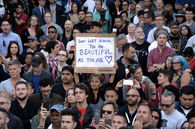 Several thousand people gather for a vigil outisde Los Angeles City Hall on Mondayin memory of the people killed at an Orlando, Fla., nightclub. Photo by Jim Ruymen/UPI