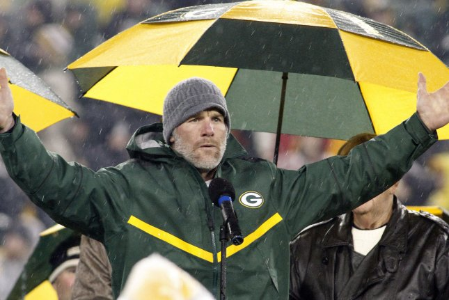 Former Green Bay Packer quarterback Brett Favre reacts to the crowd as his number is retired during a ceremony at halftime of the game between the Packers and Chicago Bears November 26, 2015, at Lambeau Field in Green Bay, Wisconsin. The Bears defeated the Packers 17-14. Photo by Frank Polich/UPI