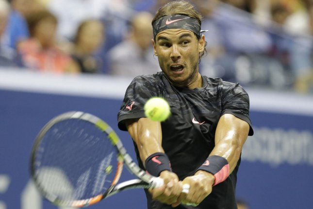 Rafael Nadal of Spain hits a backhand to Fabio Fognini of Italy in their 3rd round match on day five at the US Open Tennis Championships at the USTA Billie Jean King National Tennis Center in New York City on September 4, 2015. File photo by John Angelillo/UPI