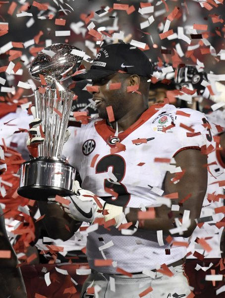 Former Georgia Bulldogs linebacker Roquan Smith holds the Leisham Trophy after defeating Oklahoma in the 2018 Rose Bowl. Smith was selected by the Chicago Bears in the first round of tge NFL draft Thursday. Photo by Juan Ocampo/UPI