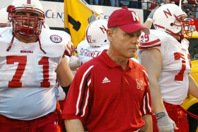Former Nebraska head football coach Frank Solich (C) leads the Cornhuskers onto the field for a game with the Missouri Tigers on October 11, 2003 at Faurot Field in Columbia, Missouri. File photo by Bill Greenblatt/UPI