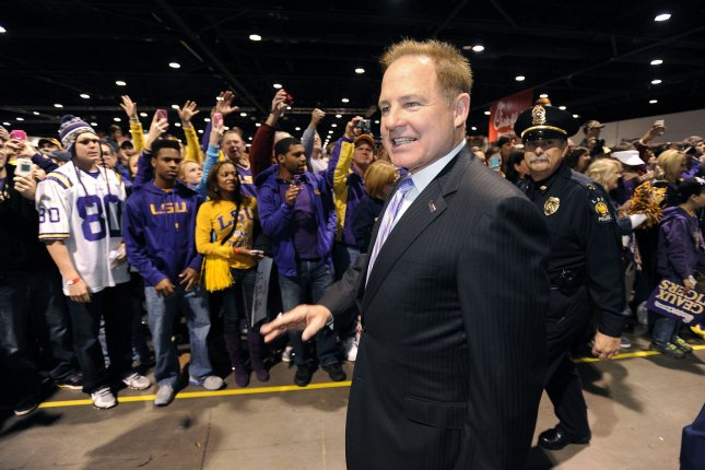 Former LSU head football coach Les Miles enters the Fan Fest at the Georgia World Congress Center prior to the LSU vs. Clemson Chick-fil-A Bowl on December 31, 2012 in Atlanta. File photo by David Tulis/UPI