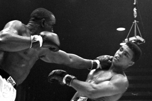 On February 25, 1964, Cassius Clay (Muhammad Ali) stunned the boxing world with a TKO of Sonny the Bear Liston, winning the world heavyweight championship. UPI File Photo