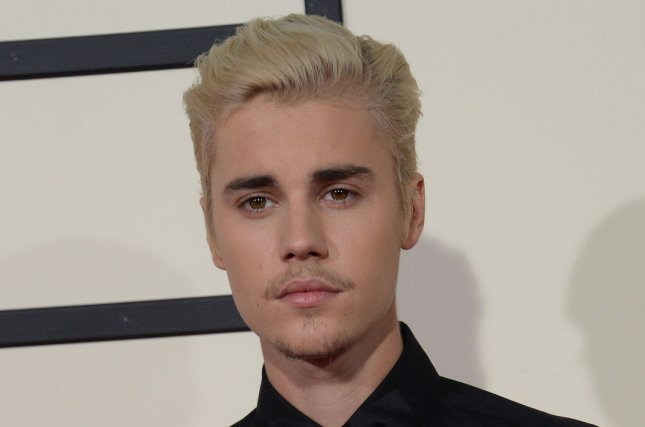 Justin Bieber has teamed up with Ludacris, Usher and Snoop Dogg for a remix of Peaches. File Photo by Jim Ruymen/UPI