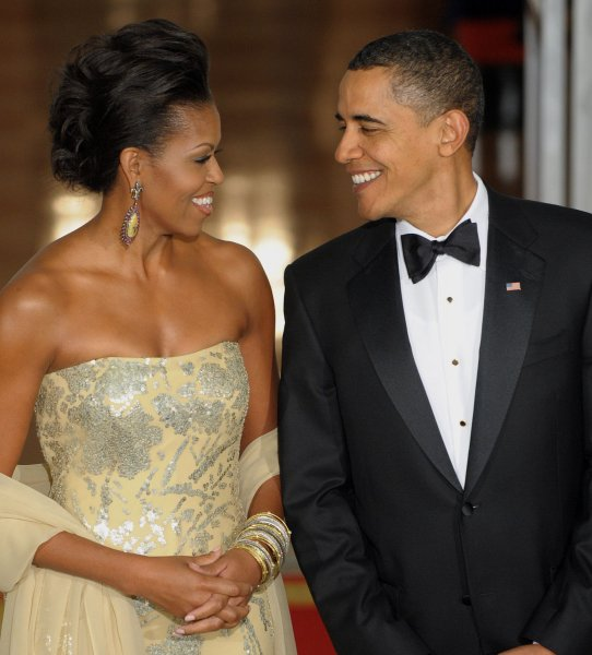 U.S. President Barack Obama and First Lady Michelle Obama arrive to welcome Indian Prime Minister Manmohan Singh and his wife Gursharan Kaur on the North Portico of the White House for a State Dinner on November 24, 2009. This is President Obama's first state dinner. UPI/Roger L. Wollenberg