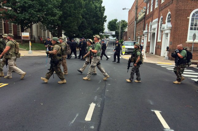 Militia members march in Charlottesville, Va., on August 12. Photo by Virginia State Police/UPI
