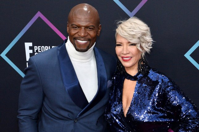 Terry Crews (L) and his wife Rebecca King-Crews. The actor is set to announce the Gold Globe Award nominations alongside Danai Gurira, Leslie Mann and Christian Slater. File Photo by Jim Ruymen/UPI
