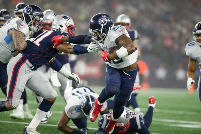 Tennessee Titans running back Derrick Henry (22) had 204 yards from scrimmage during a win against the New England Patriots Saturday in Foxborough, Mass. Photo by Matthew Healey/UPI