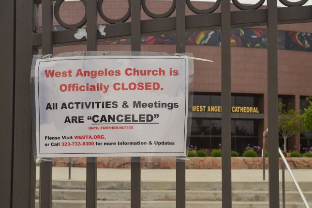 A sign informs parishioners at a Los Angeles church on April 12 that all activities and meetings were canceled until further notice as a result of the coronavirus pandemic. File Photo by Jim Ruymen/UPI