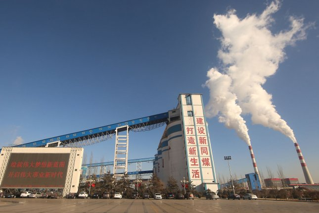 Emissions from a coal-powered plant and industrial facility are seen in Datong, Shanxi Province, China, on December 12, 2018. File Photo by Stephen Shaver/UPI