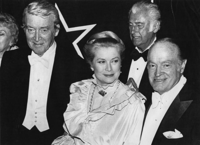 Princess Grace of Monaco, the fomer film star Grace Kelly at a gala at the University of Pennsylvania's Annenberg Center on March 31, 1982 in Philadelphia. Princess Grace was honored with a film festival, celebrating her career as a film star. She is seen here with veteran actor Jimmy Stewart on her left, Stewart Granger in the back and Bob Hope to the right. (UPI Photo/Mike Feldman/Files)