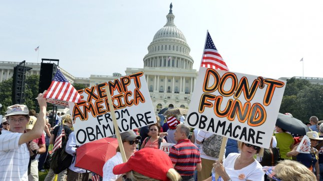 Hundreds of people gather on the grounds of the US Capitol at a Tea Party rally to push for de-funding Obamacare, The Affordable Care Act, on Capitol Hill, September 10, 2013, in Washington, DC. UPI/Mike Theiler