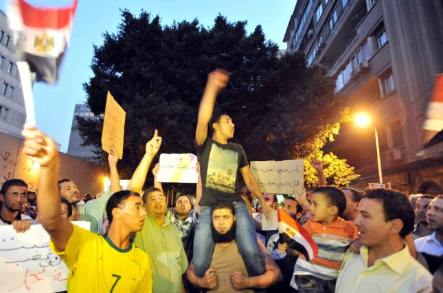 Egyptian shout slogans during a protest in front of the U.S. embassy in Cairo Sept. 12, a demonstration against a film deemed offensive to Islam and the Prophet Mohammad. In Libya, Islamic extremists killed the American ambassador as they stormed the American consulate in Benghazi in anger against the little known film by an amateur American filmmaker. UPI
