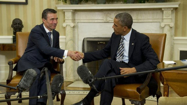 U.S. President Barack Obama (R) shakes hands with NATO Secretary General Anders Fogh Rasmussen during a meeting in the Oval Office at the White House on May 31, 2013 in Washington, D.C. UPI/Kevin Dietsch