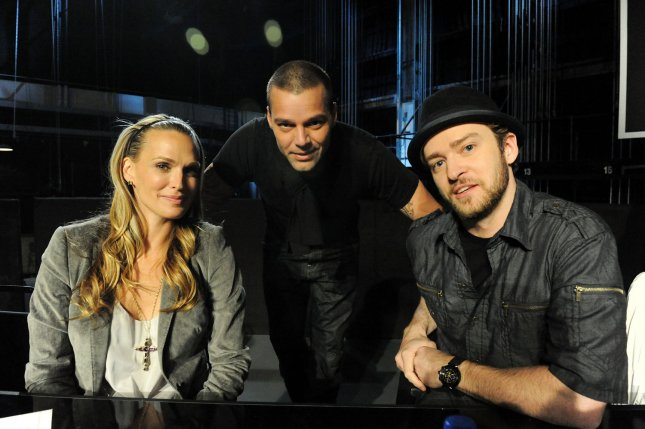 In this handout photo provided by MTV, model Molly Sims, singer Ricky Martin and musician Justin Timberlake participate in the Hope For Haiti Now: A Global Benefit For Earthquake Relief telethon on January 22, 2010 in Los Angeles. UPI/Jeff Kravitz/HO
