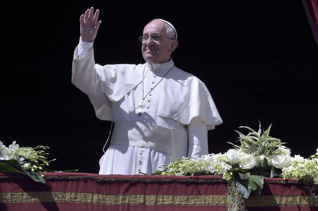Pope Francis waves during the Sunday Easter Mass 'Urbi et Orbi' (Latin for 'to the city and the world') benediction in Saint Peter's Square at the Vatican in Vatican City on April 20, 2014. The pope prayed for an end to all war and conflict as he addressed tens of thousands of the Roman Catholic faithful. (Stefano Spaziani/UPI)